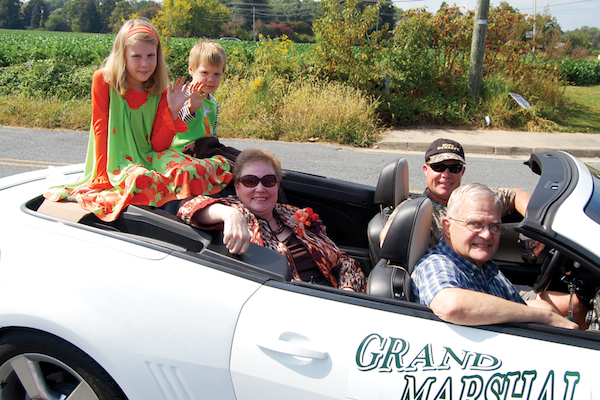 Grand Marshall Carol Chandler rides with her grandchildren, Natalie and Anthony, in the Montross Fall Festival Parade. Source: Westmoreland News