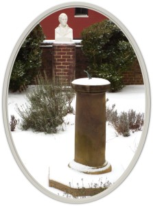 Jefferson bust and sun dial with snow