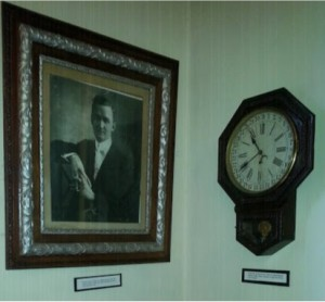 Portrait of Rev. Theodore G. Laughan, Minister when the Church was built in 1913, under whose leadership the present church was built in 1913.  Also pictured, Clock that was given to the Church by Tappahannock Building Supply, where materials to build the Church were obtained.
